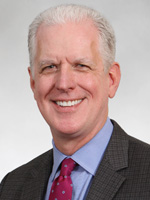 Headshot of Colin Cave, MD