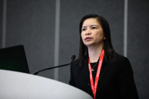 Mai Nguyen-Huynh, MD, speaking at podium